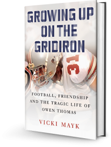 Book cover of Growing Up on the Gridiron showing Owen Thomas